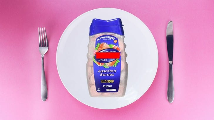 place setting with antacid bottle on plate